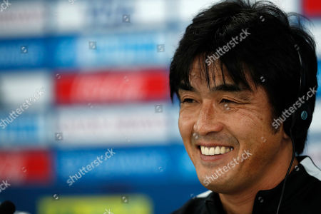 Japan's Urawa Reds head coach Takafumi Hori, speaks during a press conference with his player Yuki Abe at Zayed sport city in Abu Dhabi, United Arab Emirates, . Urawa Reds will play Al Jazira Club in a second round of the FIFA Club World Cup soccer tournament
