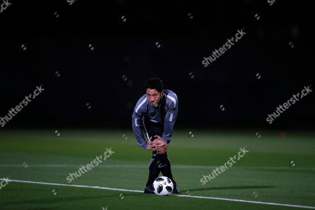 Japan's Urawa Reds player Yuki Abe stretches during a training session at Zayed sport city in Abu Dhabi, United Arab Emirates, . Urawa Reds will play Al Jazira Club in a second round of the FIFA Club World Cup soccer tournament