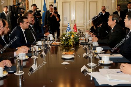 Greek Prime Minister Alexis Tsipras (2L) welcomes China?s Vice Premier Ma Kai (2R) during their meeting, at Maximos Mansion, in Athens, Greece, 08  December 2017. The focus of talks during Ma Kai's visit to Greece will be on new technology, tourism and agri-food products.