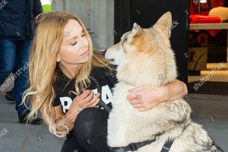 Anneka Svenska and her wolfdog Crystal Kumi