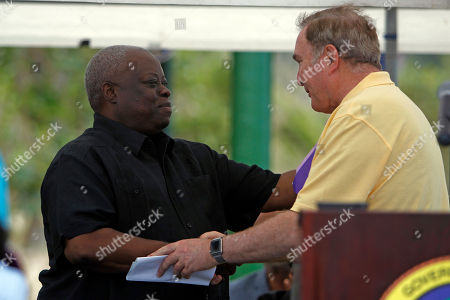 Kenneth E. Mapp, Richard D. Fain. U.S. Virgin Islands governor, Kenneth E. Mapp, left, greets Royal Caribbean Chairman & CEO, Richard D. Fain during the newly-dedicated ceremony at the Magen's Bay Beach, in St. Thomas, U.S. Virgin Islands