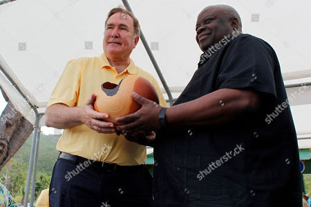 Kenneth E. Mapp, Richard D. Fain. U.S. Virgin Islands governor, Kenneth E. Mapp, right, gives an art piece as a present to Royal Caribbean Chairman & CEO, Richard D. Fain during the newly-dedicated ceremony at the Magen's Bay Beach, in St. Thomas, U.S. Virgin Islands