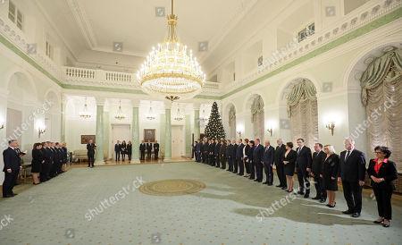Polish President Andrzej Duda (L) and members of the Polish Government (from left): Piotr Glinski, Jaroslaw Gowin, Andrzej Adamczyk, Mariusz Blaszczak, Marek Grobarczyk, Krzysztof Jurgiel, Antoni Macierewicz, Konstanty Radziwill, Elzbieta Rafalska, Anna Strezynska, Jan Szyszko, Krzysztof Trzorzewski, Witold Waszczykowski, Anna Zalewska, Zbigniew Ziobro, Mariusz Kaminski, Beata Kempa, Henryk Kowalczyk i Elzbieta Witek in the Presidential Palace in Warsaw, Poland, 08 December 2017. President Andzrej Duda will accept the resignation of the Beata Szydlo government and will nominate to-date Deputy PM Mateusz Morawiecki as new Prime Minister.
