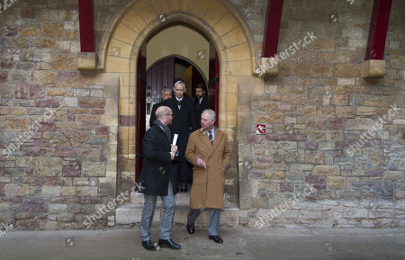 Prince Charles is shown around Castell Coch by Jason Thomas (L), Welsh Government Director of Culture, Sport and Tourism, to learn about the castle's history, refurbishment and programme of community activities