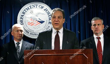 """William Weinreb, Hank Shaw, Joel Garland. Acting U.S. Attorney William Weinreb, center, is flanked by FBI Special Agent in Charge Hank Shaw, right, and IRS Special Agent in Charge Joel Garland, left, as he addresses reporters during a news conference where it was announced that former Massachusetts state Sen. Brian Joyce had been arrested, in Boston, . Joyce was charged Friday with using his office for personal profit by accepting up to $1 million in bribes and kickbacks and hiding his corrupt profits by creating a shell company and disguising them as """"legal fees"""