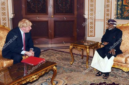 In this photo released by the state-run Oman News Agency, British Foreign Secretary Boris Johnson, left, meets Oman's ruler, Sultan Qaboos bin Said, right, in Muscat, Oman, . Johnson traveled on Friday to Oman, the West's interlocutor when dealing with Iran, as he tries to free a detained British-Iranian woman held for months by the Islamic Republic