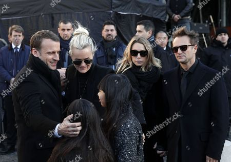 Johnny Hallyday's wife Laetitia Hallyday (2-L), his children (L-R) Joy Hallyday, Jade Hallyday, Laura Smet (2-R), David Hallyday (R) and French President Emmanuel Macron (L) stand outside the La Madeleine Church prior to the funeral ceremony in tribute to late French singer Johnny Hallyday in Paris, France, 09 December 2017. Johnny Hallyday, France's biggest rock star, has died of cancer on 06 December. He was 74.