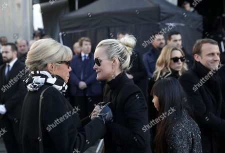 Johnny Hallyday's wife Laetitia Hallyday (L), Brigitte Macron (2-L), Laura Smet (2-R) and David Hallyday (R) stand outside the La Madeleine Church prior to the funeral ceremony in tribute to late French singer Johnny Hallyday in Paris, France, 09 December 2017. Johnny Hallyday, France's biggest rock star, has died of cancer on 06 December. He was 74.