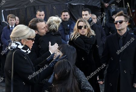 Johnny Hallyday's wife Laetitia Hallyday (C), his children (L-R)  Joy Hallyday, Jade Hallyday, Laura Smet (2-R), David Hallyday (R), French President Emmanuel Macron (2-L) and his wife Brigitte Macron (L) stand outside the La Madeleine Church prior to the funeral ceremony in tribute to late French singer Johnny Hallyday in Paris, France, 09 December 2017. Johnny Hallyday, France's biggest rock star, has died of cancer on 06 December. He was 74.
