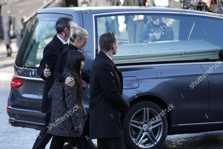Johnny Hallyday's wife Laetitia Hallyday (C), his children Jade Hallyday (L) and Joy Hallyday (R) arrive with the funeral cortege behind the coffin of late French rock legend Johnny Hallyday at the Madeleine Square in Paris, France, 09 December 2017. Johnny Hallyday, France's biggest rock star, has died of cancer on 06 December. He was 74.