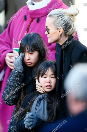 French rock star Johnny Hallyday's wife Laetitia, right, his daughters Jade, left, and Joy, react as they arrive at La Madeleine church for Johnnny Hallyday's funeral ceremony in Paris, Saturday, Dec.9, 2017. France is bidding farewell to its biggest rock star, honoring Johnny Hallyday with an exceptional funeral procession down the Champs-Elysees, a presidential speech and a motorcycle parade, all under intense security
