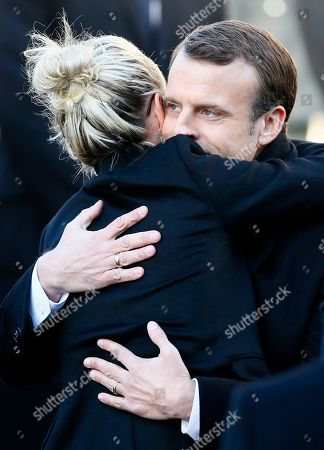 French President Emmanuel Macron hugs French rock star Johnny Hallyday's widow Laetitia at La Madeleine church during Johnny Hallyday's funeral ceremony in Paris, Saturday, Dec.9, 2017. France is bidding farewell to its biggest rock star, honoring Johnny Hallyday with an exceptional funeral procession down the Champs-Elysees, a presidential speech and a motorcycle parade, all under intense security