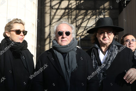 French singer Didier Barbelivien (C), his wife Laure and French cook Marc Veyrat (R) arrive at the La Madeleine Church prior to the funeral ceremony in tribute to late French singer Johnny Hallyday in Paris, France, 09 December 2017. Johnny Hallyday, France's biggest rock star, has died of cancer on 06 December. He was 74.