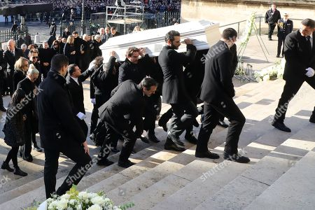 Stock Image of Relatives of late French singer Johnny Hallyday carry his coffin with French singer Maxim Nucci, aka Yodelice (3-R) and his manager Sebastien Farran (5-R) as they enter the La Madeleine Church prior to the funeral ceremony in Paris, France, 09 December 2017. Johnny Hallyday, France's biggest rock star, has died of cancer on 06 December. He was 74.