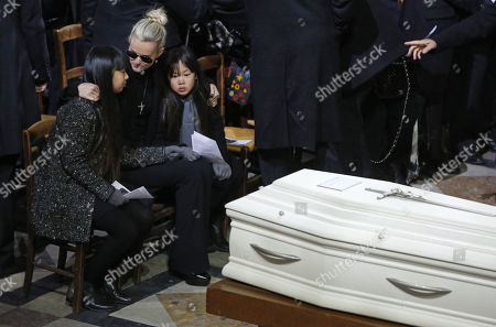 Johnny Hallyday's wife Laetitia Hallyday and their two children Jade (L) and Joy (R) attend the funeral service for late French rocker Johnny Hallyday at the La Madeleine Church in Paris, France, 09 December 2017. Johnny Hallyday, France's biggest rock star, has died of cancer on 06 December. He was 74.