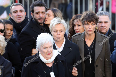 (2-L to R) French singer Maxim Nucci aka Yodelice, French singer Line Renaud, French actress and humorist Muriel Robin and her partner French actress Anne Le Nen, arrive  outside the La Madeleine Church prior to the funeral ceremony in Paris, France, 09 December 2017. Johnny Hallyday, France's biggest rock star, has died of cancer on 06 December. He was 74.
