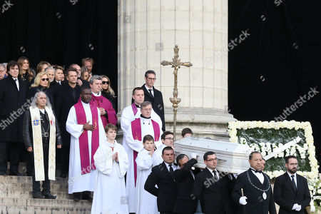 Stock Photo of Former wife of late French singer Johnny Hallyday, French singer Sylvie Vartan (2-L) and her husband US actor and film producer Tony Scotti (L), son of late French singer Johnny Hallyday David Hallyday (C) and daughter of late French singer Johnny Hallyday Laura Smet (C-R) leave La Madeleine Church at the end the funeral ceremony in tribute to late French singer Johnny Hallyday in Paris, France, 09 December 2017. Johnny Hallyday, France's biggest rock star, has died of cancer on 06 December. He was 74.