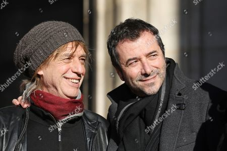 French musician and singer Jean-Louis Aubert, left, and French comedian Bernard Montiel talk outside La Madeleine Church prior to the funeral ceremony to late French rock singer Johnny Hallyday in Paris. France is bidding farewell to its biggest rock star, honoring Johnny Hallyday with an exceptional funeral procession down the Champs-Elysees, a presidential speech and a parade of motorcyclists ? all under intense security