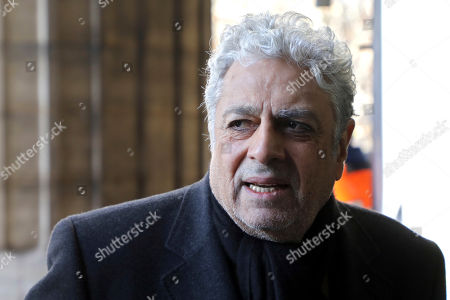French singer Enrico Macias arrives at La Madeleine Church prior to the funeral ceremony to late French rock singer Johnny Hallyday in Paris. France is bidding farewell to its biggest rock star, honoring Johnny Hallyday with an exceptional funeral procession down the Champs-Elysees, a presidential speech and a parade of motorcyclists ? all under intense security