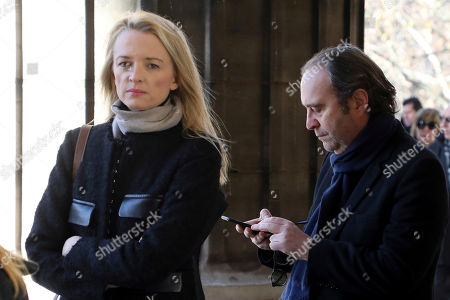 French telecom Iliad Group founder and Vice President Xavier Niel, right, and Director and executive Vice President of Louis Vuitton Delphine Arnault arrive at La Madeleine Church prior to the funeral ceremony to late French rock singer Johnny Hallyday in Paris. France is bidding farewell to its biggest rock star, honoring Johnny Hallyday with an exceptional funeral procession down the Champs-Elysees, a presidential speech and a parade of motorcyclists ? all under intense security