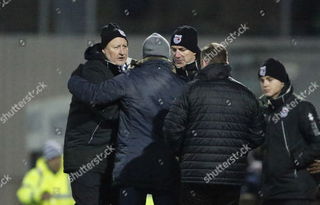 Russell Slade Manager of Grimsby Town and Paul Wilkinson Assistant Manager of Grimsby Town shake hands with Forest Green Rovers manager, Mark Cooper at full time during the EFL Sky Bet League 2 match between Grimsby Town FC and Forest Green Rovers at Blundell Park, Grimsby