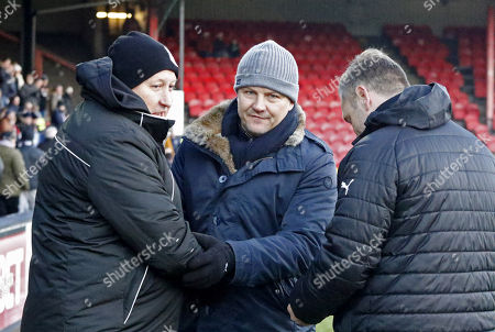 Russell Slade Manager of Grimsby Town and Forest Green Rovers manager, Mark Cooper shake hands  during the EFL Sky Bet League 2 match between Grimsby Town FC and Forest Green Rovers at Blundell Park, Grimsby