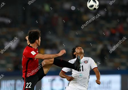 Japan's Urawa Reds Yuki Abe, left, challenges for the ball with Al Jazira's Romarinho during the Club World Cup soccer match between Al Jazira Club and Urawa Reds at Zayed sport city in Abu Dhabi, United Arab Emirates