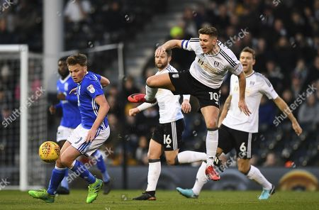 Tom Cairney of Fulham is sent flying by Stephen Gleeson of Birmingham City