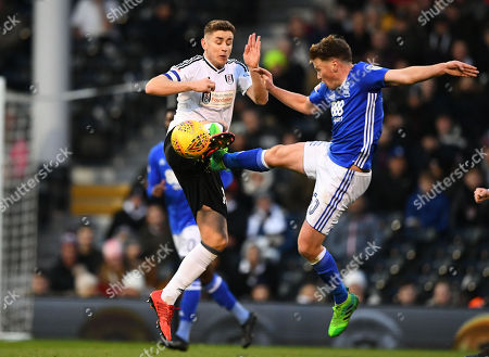 Stephen Gleeson of Birmingham City catches Tom Cairney of Fulham on the leg
