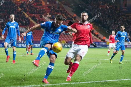 Portsmouth Gareth Evans (26) clears the ball from Charlton Leon Best (8) during the EFL Sky Bet League 1 match between Charlton Athletic and Portsmouth at The Valley, London