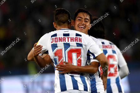 Jonathan Urretaviscaya and Erick Sanchez of CF Pachuca celebrate the winning goal by Victor Guzman in the extra time of the FIFA Club World Cup match between CF Pachuca and Wydad Casablanca in Abu Dhabi, UAE, 09 December 2017.