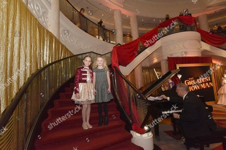 """Austyn Johnson, Cameron Seely. Austyn Johnson, left, and Cameron Seely attend as Cunard Hosts the World Premiere of 20th Century Fox's """"The Greatest Showman"""" on board Queen Mary 2, in Brooklyn, N.Y. This is the first ever major motion picture premier to take place on board a passenger ship"""