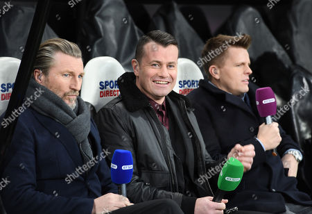 (l-r) Robbie Savage, Shay Given and Jake Humphrey prepare to do a live broadcast from the dugout before kick off