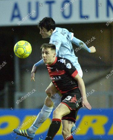 Warrepoint Town v Crusaders. Warrenpoints Danny Wallace in action with Crusaders Gavin Whyte