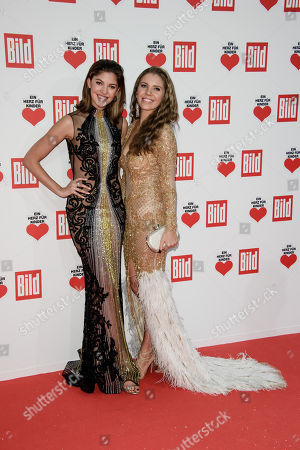 Austrian singer Victoria Swarovski (R) and her sister Paulina poses as she arrives for the charity gala 'Ein Herz fuer Kinder' (A Heart for Children) in Berlin, Germany, 09 December 2017. German television channel ZDF and newspaper 'Bild' collected donations for children's charity organizations in Germany and the whole world.