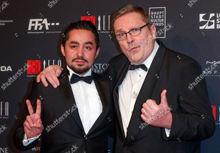 Syrian-Finnish actor Sherwan Haji (L) and Finnish singer and actor Sakari Kuosmanen arrives on the red carpet for the 30th European Film Awards, in Berlin, Germany, 09 December 2017.  The nominations and winners are selected by more than 2,500 members of the European Film Academy.