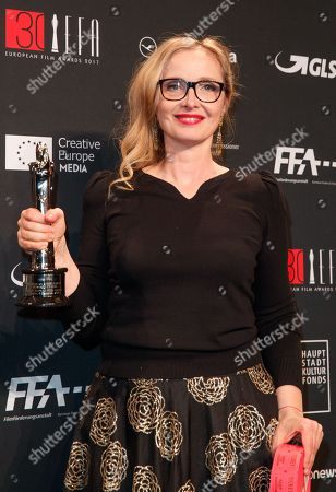 French actress Julie Delpy poses with the 'European achievement in world cinema award' at the 30th European Film Awards, in Berlin, Germany, 09 December 2017.  The nominations and winners are selected by more than 2,500 members of the European Film Academy.