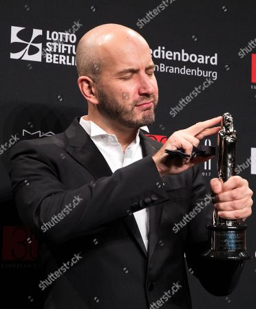 Composer Evgueni Galperine poses with the European Composer 2017 award at the 30th European Film Awards, in Berlin, Germany, 09 December 2017.  The nominations and winners are selected by more than 2,500 members of the European Film Academy.