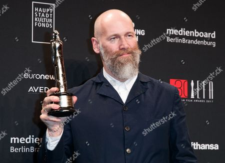 Russian cinematographer Director of Photography Mikhail Krichman poses with his award for best 'European Cinematographer' at the 30th European Film Awards, in Berlin, Germany, 09 December 2017.  The nominations and winners are selected by more than 2,500 members of the European Film Academy.