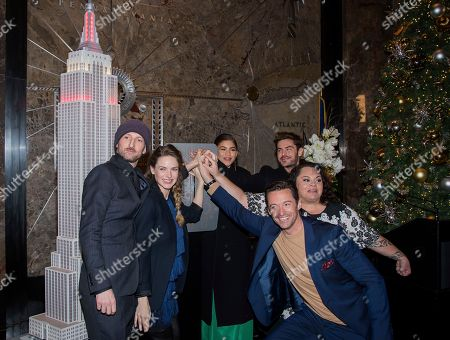 """Michael Gracey, Rebecca Ferguson, Zendaya, Hugh Jackman, Zac Efron, Keala Settle. Michael Gracey, from left, Rebecca Ferguson, Zendaya, Hugh Jackman, Zac Efron and Keala Settle participate in a lighting ceremony at the Empire State Building to promote """"The Greatest Showman"""" film, in New York"""