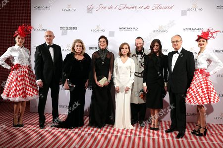 Princess Caroline of Hanover (2-L), Director of the Monte-Carlo Casino, Pascal Camia (L), Director of the SBM (Societe des Bains de Mer) Jean-Luc Biamonti (3-R), Belgian artist Charles Kaisin (2-R), French actresses Isabelle Huppert (C), Catherine Deneuve (3-L) and his daughter Chiara Mastroianni (2-R) arrive for the Surrealist Dinner Party at the Monte-Carlo Casino in Monaco, 09 December 2017.
