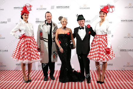 Belgian artist Charles Kaisin (2-L), Marquise Roberta Gilardi Sestito (C) and her husband Donato Sestito (2-R) arrive for the Surrealist Dinner Party at the Monte-Carlo Casino in Monaco, 09 December 2017.
