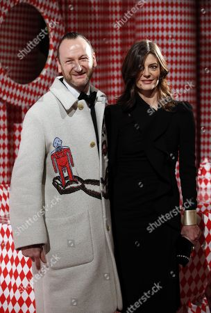 Belgian artist Charles Kaisin (L) and Chiara Mastroianni (R) arrive for the Surrealist Dinner Party at the Monte-Carlo Casino in Monaco, 09 December 2017.