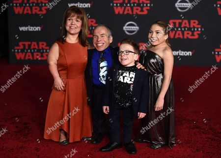 "Warwick Davis, Samantha Davis, Lloyd Davis, Annabelle Davis. Warwick Davis, Samantha Davis, Lloyd Davis and Annabelle Davis arrive at the Los Angeles premiere of ""Star Wars: The Last Jedi"" at the Shrine Auditorium on in Los Angeles"