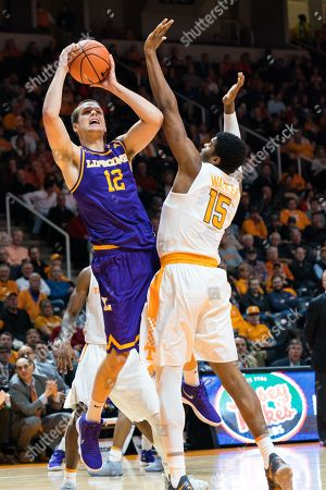 Matt Rose #12 of the Lipscomb Bisons shoots the ball over Derrick Walker #15 of the Tennessee Volunteers during the NCAA basketball game between the University of Tennessee Volunteers and the Lipscomb University Bisons at Thompson Boling Arena in Knoxville TN Tim Gangloff/CSM