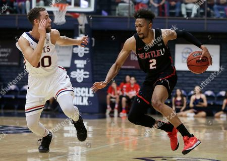Jordan Ford, Jordan Hill. Seattle's Jordan Hill, right, drives the ball against Saint Mary's Jordan Ford during the first half of an NCAA college basketball game, in Moraga, Calif