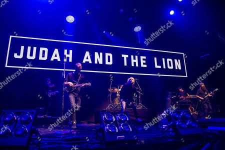 Brian Macdonald, Judah Akers, Nate Zuercher. Brian Macdonald, from left, Judah Akers and Nate Zuercher of Judah & The Lion perform at the 2017 KROQ Almost Acoustic Christmas at The Forum, in Inglewood, Calif