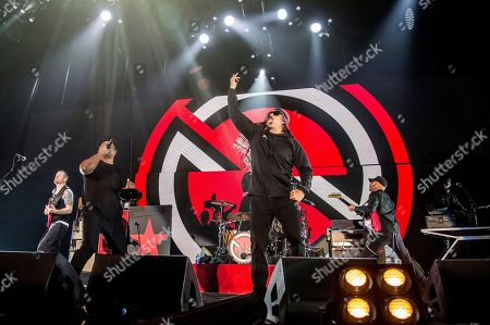 Tim Commerford, Chuck D, B-Real, Tom Morello. Tim Commerford, from left, Chuck D, B-Real and Tom Morello of Prophets of Rage perform at the 2017 KROQ Almost Acoustic Christmas at The Forum, in Inglewood, Calif
