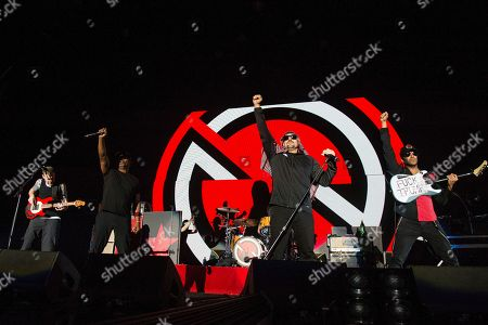 Stock Image of Tim Commerford, Chuck D, B-Real, Tom Morello. Tim Commerford, from left, Chuck D, B-Real and Tom Morello of Prophets of Rage perform at the 2017 KROQ Almost Acoustic Christmas at The Forum, in Inglewood, Calif