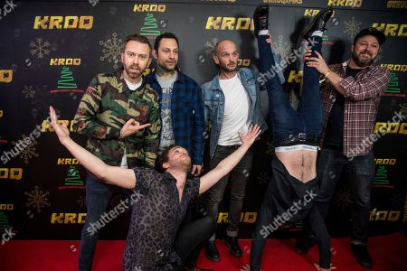 Tim McIlrath, Joe Principe, Zach Blair, Brandon Barnes. Tim McIlrath, from left, Joe Principe, Zach Blair and Brandon Barnes of Rise Against pose with Mike Kerr and Ben Thatcher of Royal Blood at the 2017 KROQ Almost Acoustic Christmas at The Forum, in Inglewood, Calif